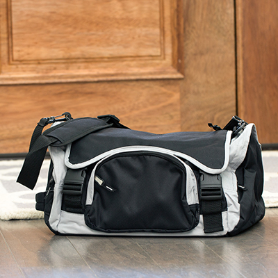 TOPPERS™ Multi-Functional Travel Duffel - This overnight travel bag offers lots of storage options for all your essentials.  Features a large, main compartment, three outside zippered pockets, adjustable shoulder strap and buddy handle.  Detachable amenity case is also included with a hanging hook, three zippered pockets and buckles to attach case to the main travel duffel.  Duffel measures 18