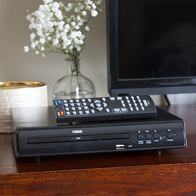 NAXA<sup>&reg;</sup> Digital DVD Player - This player is DVD/MPEG4/CD-R/CD-RW/CD compatible.  Features include 2.0 audio output, full function remote control, multi-angle viewing, audio/video output jacks and AV cable.